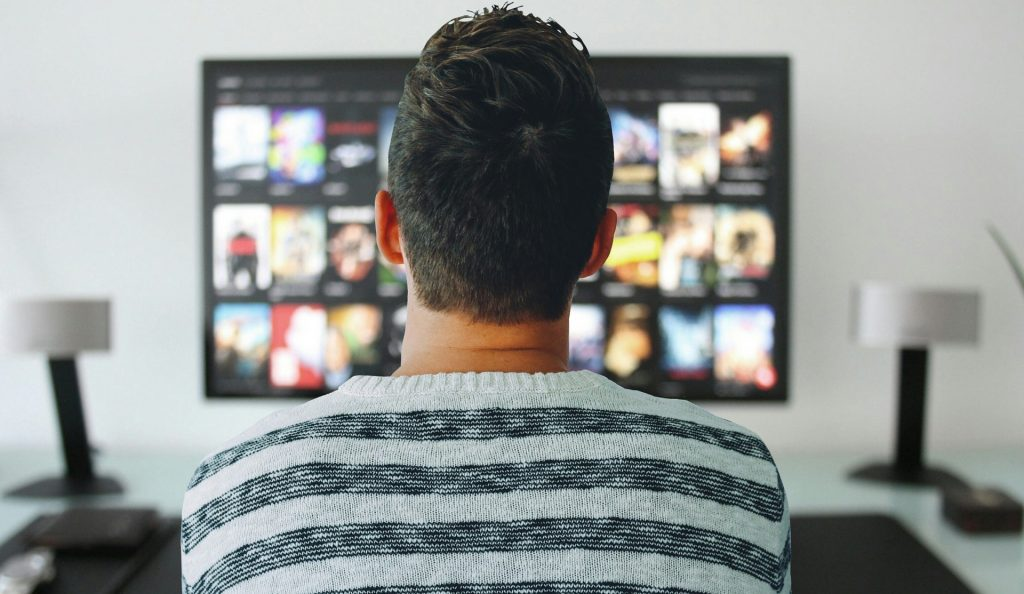 Man watches Netflix on TV