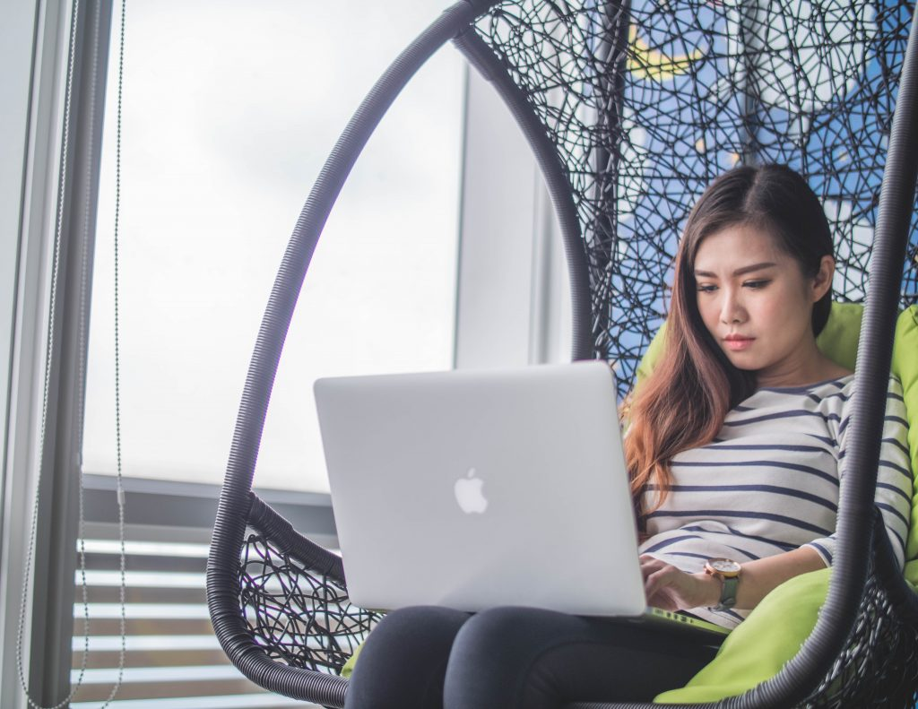 Asian Freelancer researching through a computer