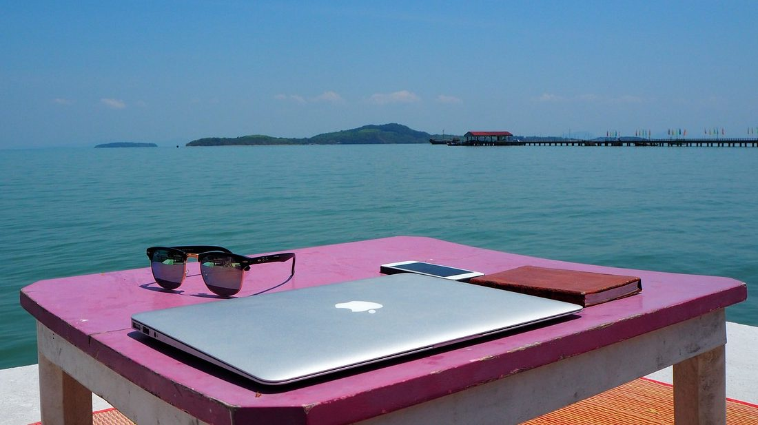 Laptop by the beach side in Southeast Asia