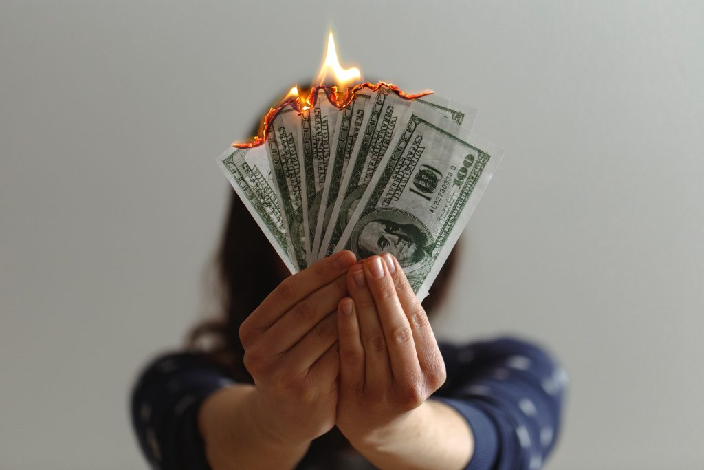 Spending, wasting, and burning money