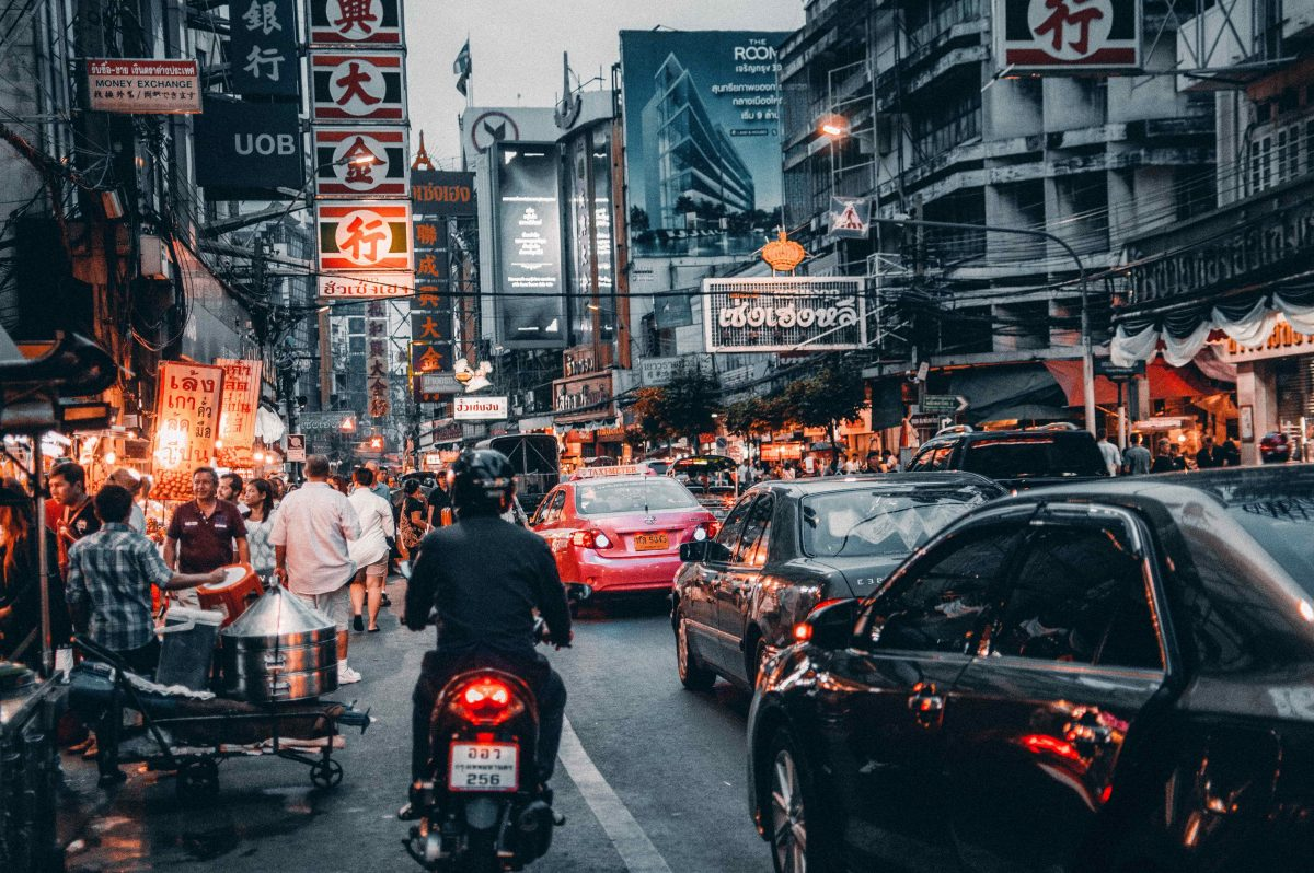 Cars and motorcycle in congested street in Thailand