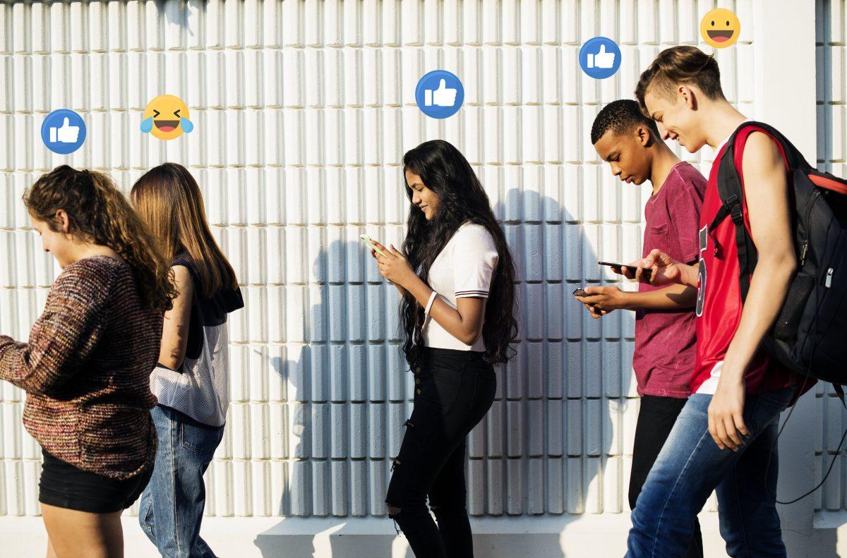 Millennials on social media using smartphone in public